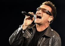 <p>Lead singer Bono of Irish rock band U2 performs a concert at the Olympic stadium in Turin, northern Italy August 6, 2010. REUTERS/Stefano Rellandini</p>