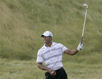 <p>Tiger Woods of the U.S. looks at his shot from the rough on the 11th hole during a practice round for the 92nd PGA Golf Championship at Whistling Straits, in Kohler, Wisconsin, August 11, 2010. REUTERS/Matt Sullivan</p>
