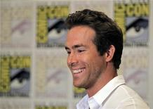 """<p>Actor Ryan Reynolds, who will play the lead in the upcoming Warner Bros motion picture """"Green Lantern"""", smiles for the cameras at Comic Con in San Diego, California July 24, 2010. REUTERS/Mike Blake</p>"""