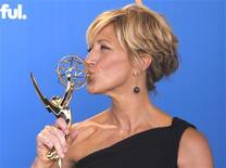 <p>Edie Falco poses with her award for outstanding lead actress in a comedy series for 'Nurse Jackie' backstage at the 62nd annual Primetime Emmy Awards in Los Angeles, California, August 29, 2010. REUTERS/Danny Moloshok</p>