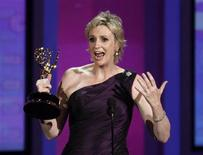 """<p>Jane Lynch accepts the award for outstanding supporting actress in a comedy series for """"Glee"""" at the 62nd annual Primetime Emmy Awards in Los Angeles, California August 29, 2010. REUTERS/Lucy Nicholson</p>"""