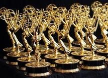 <p>Dozens of Emmy Awards are lined up on the trophy table in the media center at the 62nd annual Primetime Emmy Awards in Los Angeles, California August 29, 2010. REUTERS/Danny Moloshok</p>