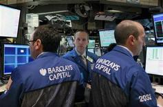 <p>Traders work at the Barclays Capital kiosk on the floor of the New York Stock Exchange April 26, 2010. REUTERS/Brendan McDermid</p>