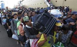 <p>People queue to board the ship which will take them to their hometown ahead of the Muslim Eid al-Fitr holiday at the Tanjung Priok harbour in Jakarta September 7, 2010. REUTERS/Supri</p>