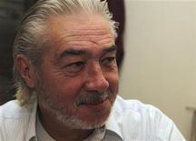 <p>Veteran Syrian director Najdat Anzour smiles at his office in Damascus September 6, 2010. REUTERS/Khaled al-Hariri</p>