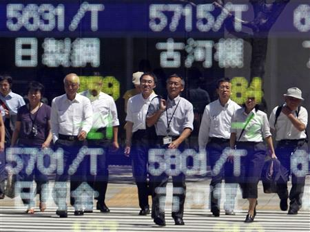 People are reflected in a stock index board outside a brokerage in Tokyo August 31, 2010. REUTERS/Kim Kyung-Hoon