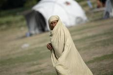 <p>A Pakistani woman, a flood victim, walks in a relief camp in Charsadda, Pakistan's northwest Khyber-Pakhtunkhwa Province, September 8, 2010. REUTERS/Morteza Nikoubazl</p>