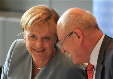 German Chancellor and head of the Christian Democratic Union (CDU) party Angela Merkel (L) talks with the head of the CDU parliamentary faction Volker Kauder attend a meeting of CDU/CSU group in the Bundestag, the German lower house of parliament, in Berlin, September 8, 2010. REUTERS/Thomas Peter