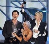 <p>Lady Gaga accepts the award for best pop video for 'Bad Romance' from 'Glee' cast members Cory Monteith (L) and Jane Lynch at the 2010 MTV Video Music Awards in Los Angeles, California September 12, 2010. REUTERS/Mike Blake</p>