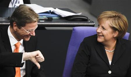 German Chancellor Angela Merkel listens to Foreign Minister Guido Westerwelle at the meeting of the Bundestag lower house of parliament in Berlin, September 15, 2010. REUTERS/Tobias Schwarz