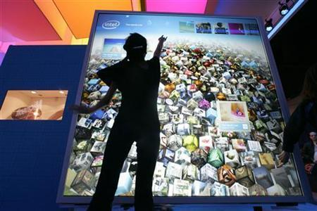 Karen Nguyen interacts with a display at the Intel booth during the 2010 International Consumer Electronics Show (CES) in Las Vegas, Nevada, January 8, 2010. REUTERS/Steve Marcus