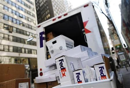 FedEx boxes are seen outside a delivery truck in New York in this March 18, 2010 file photo. REUTERS/Shannon Stapleton