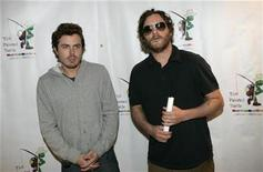 """<p>Actors Casey Affleck (L) and Joaquin Phoenix pose for photographers as they arrive for a staged reading of """"The World of Nick Adams,"""" at Davies Symphony Hall in San Francisco, California October 27, 2008. REUTERS/Robert Galbraith</p>"""