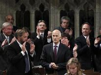 <p>New Democratic Party leader Jack Layton (C) receives a standing ovation from his caucus while speaking during Question Period in the House of Commons on Parliament Hill in Ottawa September 20, 2010. REUTERS/Chris Wattie</p>