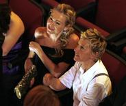<p>Talk show host and nominee Ellen Degeneres (R) and partner actress Portia de Rossi wait for the show to start at the 36th Annual Daytime Emmy Awards at the Orpheum Theatre in Los Angeles, August 30, 2009. REUTERS/Danny Moloshok</p>
