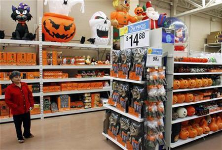 avilia palenca looks at halloween merchandise at the new 142000 square foot wal mart during the grand opening in chicago september 27 2006 - Walmart Halloween Decorations
