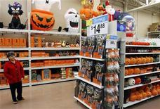 <p>Avilia Palenca looks at Halloween merchandise at the new 142,000 square foot Wal-Mart during the grand opening in Chicago, September 27, 2006. REUTERS/Joshua Lott</p>