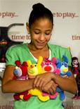 <p>Stephanie, from the New York Foundling child welfare agency, holds the Sing-A-Ma-Jigs dolls from Mattel, one of the 16 toys included in the TimetoPlayMag.com Most Wanted list of hot holiday toys, during a press conference at the Time to Play Holiday Showcase in New York, September 28, 2010. REUTERS/Ray Stubblebine/Time to Play/Handout</p>