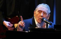"""<p>Singer Jerry Lee Lewis performs during his appearance at """"An Evening with Jerry Lee Lewis"""" at the Grammy Museum in Los Angeles September 28, 2010. Lewis celebrates his 75th birthday on Wednesday and he just released a new album """"Mean Old Man"""". But a Q&A session with the rock 'n' roll legend at the Grammy Museum on Tuesday was an uncomfortable experience as a blank-faced Lewis sat at a piano and mumbled brief answers to a moderator's questions that he had heard a million times before. REUTERS/Fred Prouser</p>"""