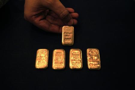 A jeweller displays gold ingots at his shop in Peshawar, northwest Pakistan on September 23, 2010. REUTERS/Fayaz Aziz