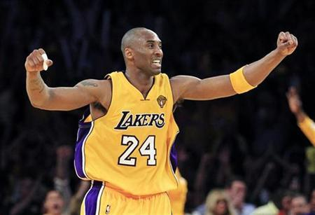 Los Angeles Lakers Kobe Bryant celebrates a basket by Ron Artest against the Boston Celtics during the fourth quarter in Game 7 of the 2010 NBA Finals basketball series in Los Angeles, California June 17, 2010 . REUTERS/Mike Blake