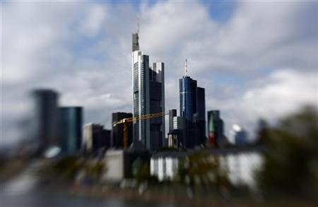 The skyline of Frankfurt with its bank towers is seen under clouds September 26, 2010. Picture is taken with a tilt and shift lense. REUTERS/Kai Pfaffenbach