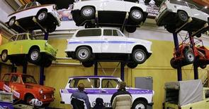 """<p>File photo of visitors looking at different models of Trabant cars at a exhibition at the 50th anniversary of the Trabant car in Zwickau November 10, 2007. German car enthusiasts took their Trabant -- the iconic car of communist East Germany -- to the limit while celebrating the 20th anniversary of German reunification, reaching a top speed of 235 km/h (145 mph). Maik und Ronny Urland claim they have set a new speed record October 3, 2010, for the two-cylinder """"Trabi"""", a remarkable feat considering the boxy clunker's reputation as slow and unreliable. REUTERS/Hannibal Hanschke</p>"""