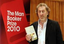 """<p>Howard Jacobson, one of the shortlisted authors for the 2010 Man Booker Prize, poses with his book """"The Finkler Question"""", in London October 10, 2010. The winner of the 50,000 pound ($76,790) prize, which can catapult an unknown author to worldwide success, will be announced on October 12. REUTERS/Paul Hackett</p>"""