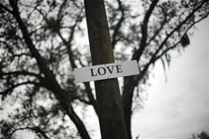 <p>A sign which reads 'Love' is seen on a tree at the tent city homeless community, known as Pinellas Hope in Pinellas Park, Florida June 6, 2009. REUTERS/Carlos Barria</p>