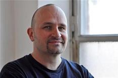 "<p>German comic and advertising consultant Dominik Kuhn discusses the success of his internet video hit ""Viral marketing in Stuttgart Death Star"" October 12, 2010. REUTERS/David Graham</p>"