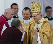<p>Papal delegate Archbishop Angelo Amato (R) greets Marianna Popieluszko, mother of Father Jerzy Popieluszko at beatification mass on Plac Pilsudskiego in center of Warsaw June 6, 2010. REUTERS/Peter Andrews</p>