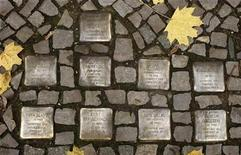 """<p>So-called """"Stolpersteine"""" (stumbling blocks), memorial pavement plaques commemorating German Jews who died in the concentration camps of Auschwitz and Theresienstadt, are pictured in Berlin's Wilmersdorf district November 7, 2008. REUTERS/Fabrizio Bensch</p>"""
