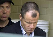 <p>Colonel Russell Williams, former Commander of Canadian Forces Base Trenton, is escorted from Belleville court after being sentenced October 21, 2010. REUTERS/Fred Thornhill</p>