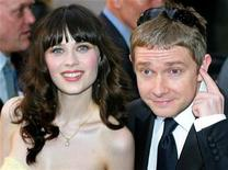 <p>Actors Zooey Deschanel (L) and Martin Freeman pose for photographers as they arrive in London's Leicester Square for the World Premiere of the Hitchiker's Guide to the Galaxy April 20, 2005.</p>
