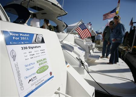 Visitors tour a motor yacht for sale at the United States Powerboat Show in Annapolis, Maryland, October 17, 2010. REUTERS/Molly Riley