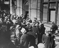 <p>File photo of people milling about outside of a bank during the Great Depression, 1933. REUTERS/Franklin D. Roosevelt Presidential Library and Museum/National Archives and Records Administration/Handout</p>