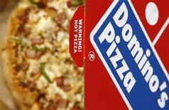 <p>A Domino's Pizza is pictured in its box in central London, February 15, 2009. REUTERS/Luke MacGregor</p>