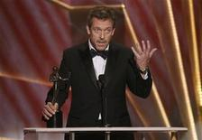 "<p>Actor Hugh Laurie accepts the award for Outstanding Performance by a Male Actor in a Drama Series for ""House"" at the 15th annual Screen Actors Guild Awards in Los Angeles January 25, 2009. REUTERS/Lucy Nicholson</p>"