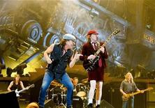 <p>Rock band AC/DC lead guitarist Angus Young (R) and vocalist Brian Johnson perform during a concert at the Telenor Arena in Fornebu, near Oslo February 18, 2009. REUTERS/Sara Johannessen/Scanpix Norway S.</p>
