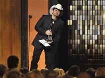 <p>Singer Brad Paisley accepts the Entertainer of the Year award at the 44th annual Country Music Association Awards in Nashville, Tennessee November 10, 2010. REUTERS/Tami Chappell</p>