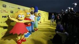 <p>Characters (from L-R) Lisa, Bart, Homer, Marge and Maggie stand are shown in Santa Monica, California in this October 18, 2009 file photo. REUTERS/Mario Anzuoni</p>