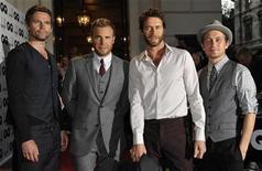 """<p>Imagen de archivo del grupo Take That durante una ceremonia de premiación en Londres. Sep 8 2009 El nuevo álbum del grupo Take That """"Progress"""", lanzado esta semana, es el más rápidamente vendido en el siglo en Gran Bretaña, según la empresa Official Charts Company. REUTERS/Toby Melville/ARCHIVO</p>"""