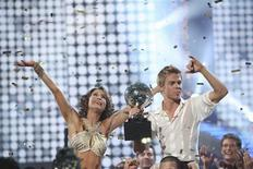 "<p>Professional dancer Derek Hough and his partner Jennifer Grey celebrate after being named champions of ""Dancing with the Stars"" and winners of the coveted mirror ball trophy during the finale show in this November 23, 2010 handout photo. REUTERS/Adam Larkey/Handout</p>"