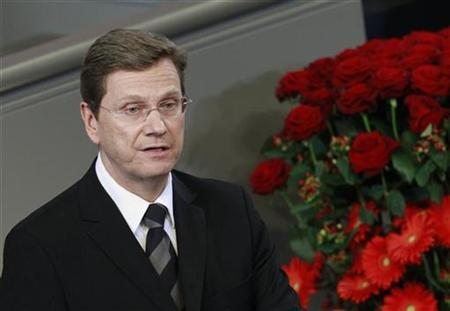 German Foreign Minister Guido Westerwelle (C) speaks during ceremony marking National Day of Mourning in the Reichstag in Berlin, November 14, 2010. REUTERS/Thomas Peter
