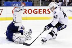 <p>Tampa Bay Lightning Dana Tyrell is stopped on a shot by Toronto Maple Leafs goalie Jonas Gustavsson during the frist period of their NHL game in Toronto, November 30, 2010. REUTERS/Mark Blinch</p>