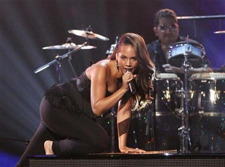 Alicia Keys performs 'Adore' during the tribute to Prince for his Lifetime Achievement Award at the 2010 BET Awards in Los Angeles June 27, 2010. REUTERS/Mario Anzuoni