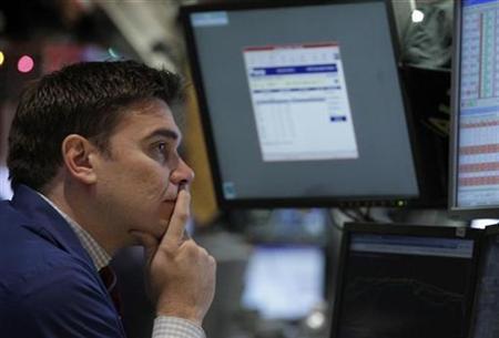 A trader work on the floor of the New York Stock Exchange, November 29, 2010. REUTERS/Brendan McDermid