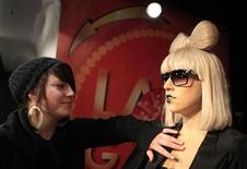 <p>A visitor touches a wax figure of singer Lady Gaga after its unveiling at the Madame Tussauds museum in Berlin, December 9, 2010. REUTERS/Thomas Peter</p>