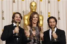 "<p>Best motion picture winners Mark Boal (L), Kathryn Bigelow (C) and Greg Shapiro of the film ""The Hurt Locker,"" display their Oscars at the 82nd Academy Awards in Hollywood March 7, 2010. REUTERS/Lucy Nicholson</p>"