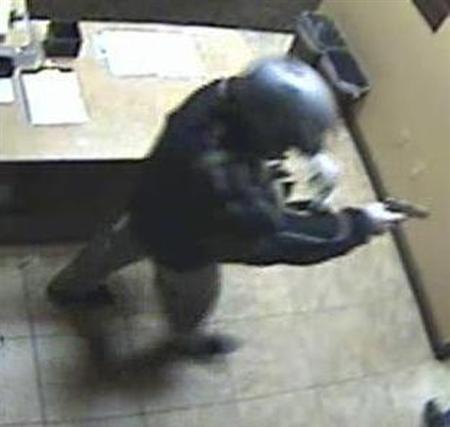 A man with a gun is shown at the scene of a robbery at the Las Vegas Suncoast Casino poker room cashier in this photo taken by surveillance camera on December 9, 2010 and released by the Las Vegas Police Department (LVPD) to Reuters December 14, 2010. LVPD believe the same man robbed the Bellagio Casino of $1.5 million in chips early on Tuesday. REUTERS/Las Vegas Police Department/Handout